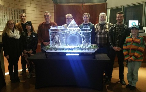 Big Print Show contestants pose with Culinary Arts professor Patrick Stewart's ice sculpture.