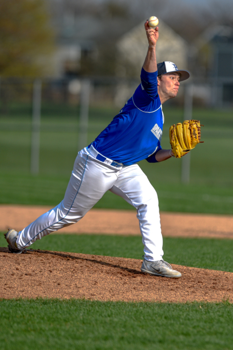 Jon Lenz releases a pitch in ECC's rout of Highland CC (Freeport)