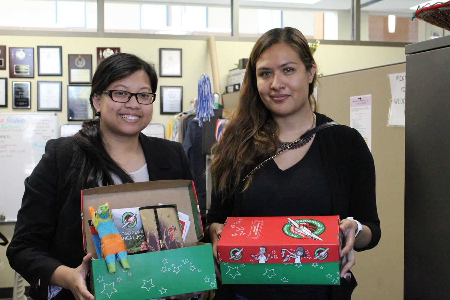 USAC President, Eloisa Basilio and Educational Officer, Estefania Sanchez with finished boxes for Operation Christmas Child