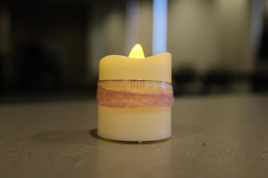 A candle turned on for Transgender Day of Remembrance,