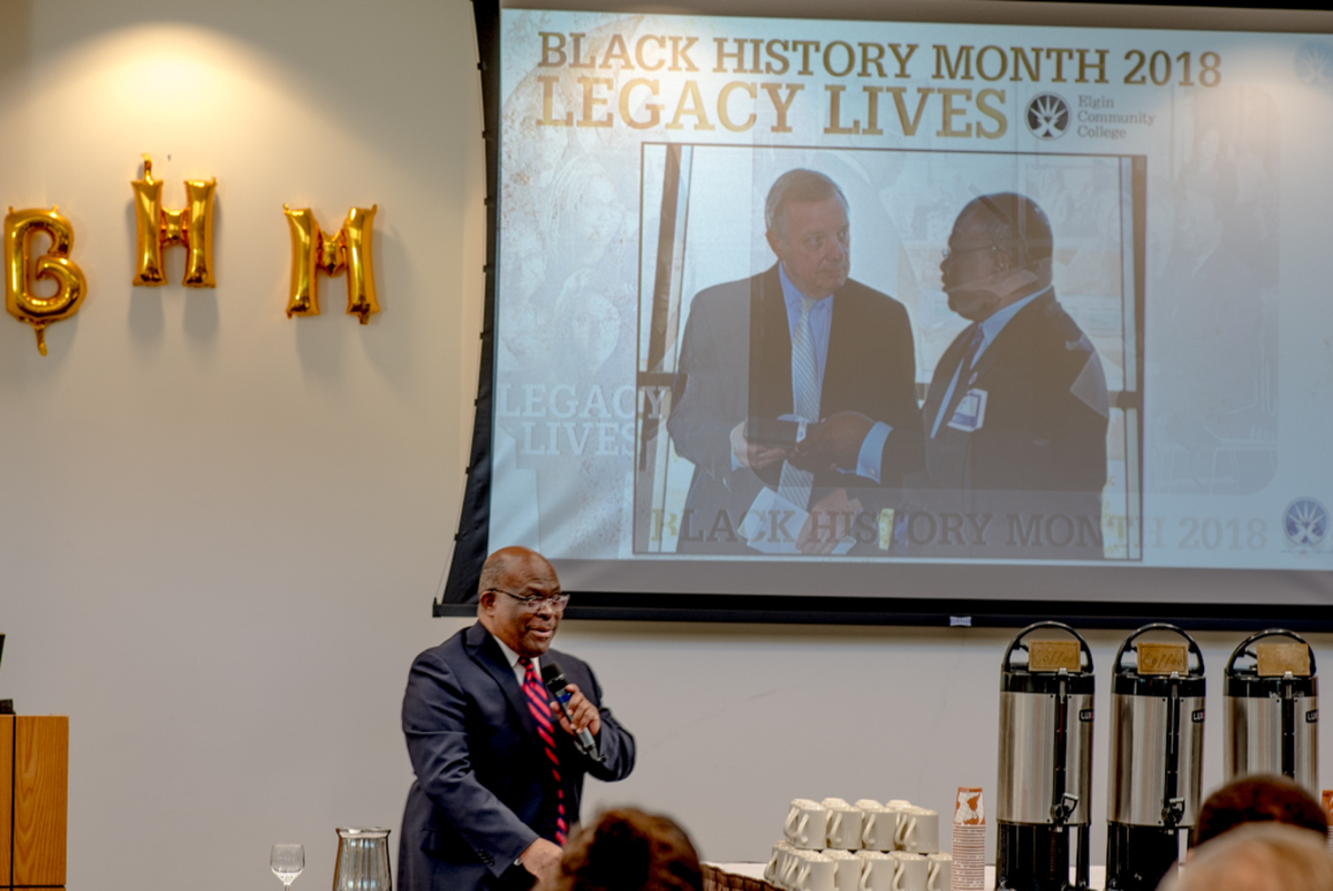 Dr. Sam kicks off the Black History Month breakfast with opening remarks.
