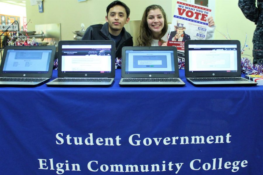 Student Government members Sen. Dario Flores (left) and Treasurer Abigail Anderson (right) waiting to help students register to vote.