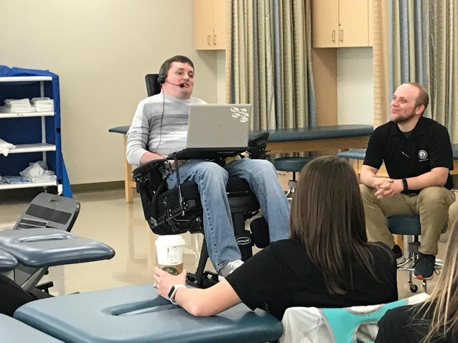 Assistant Professor of English John Mravik visited a group of students from the PTA (physical therapist assistant) program on March 23. Mravik, a quadriplegic and former ECC Orrin G. Thompson Teaching Excellence Award winner, spoke to them about handling wheel-chair bound patients.
