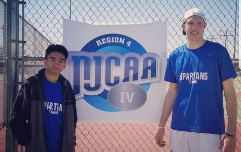 Ali Mujtaba and his partner, Allen Johanson, pose alongside a NJCAA banner after their National qualifying win. Photo provided by: Ali Mujtaba