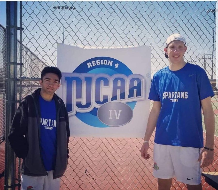 Ali+Mujtaba+and+his+partner%2C+Allen+Johanson%2C+pose+alongside+a+NJCAA+banner+after+their+National+qualifying+win.+Photo+provided+by%3A+Ali+Mujtaba