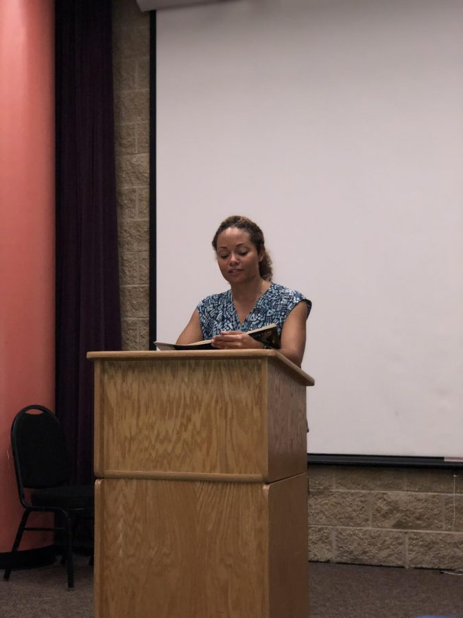 C.M.+Burroughs+reciting+her+poetry+to+the+audience+during+the+reading+series+at+ECC.+