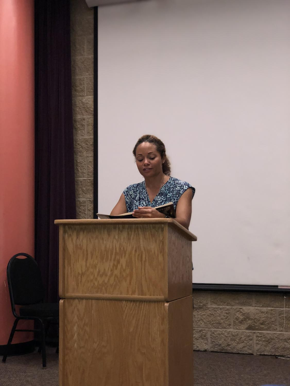 C.M. Burroughs reciting her poetry to the audience during the reading series at ECC.