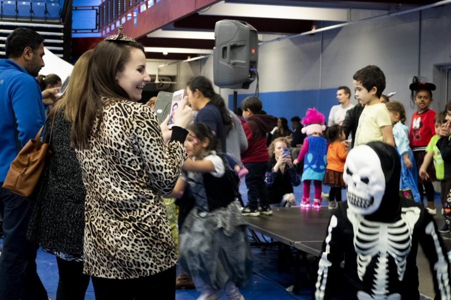 Children+and+their+families+attend+Boo+Bash+to+dance%2C+have+fun%2C+and+collect+candy+from+various+ECC+clubs+and+groups+in+the+Events+Center+Gym+on+Friday%2C+October+26.+