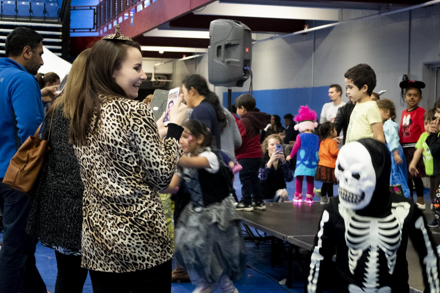 Children and their families attend Boo Bash to dance, have fun, and collect candy from various ECC clubs and groups in the Events Center Gym on Friday, October 26.