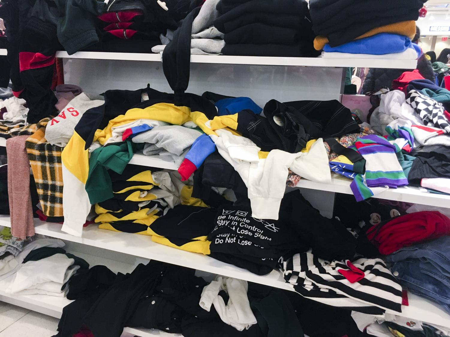 Shelves of sweaters rummaged through in Forever 21 on Black Friday, November 23.