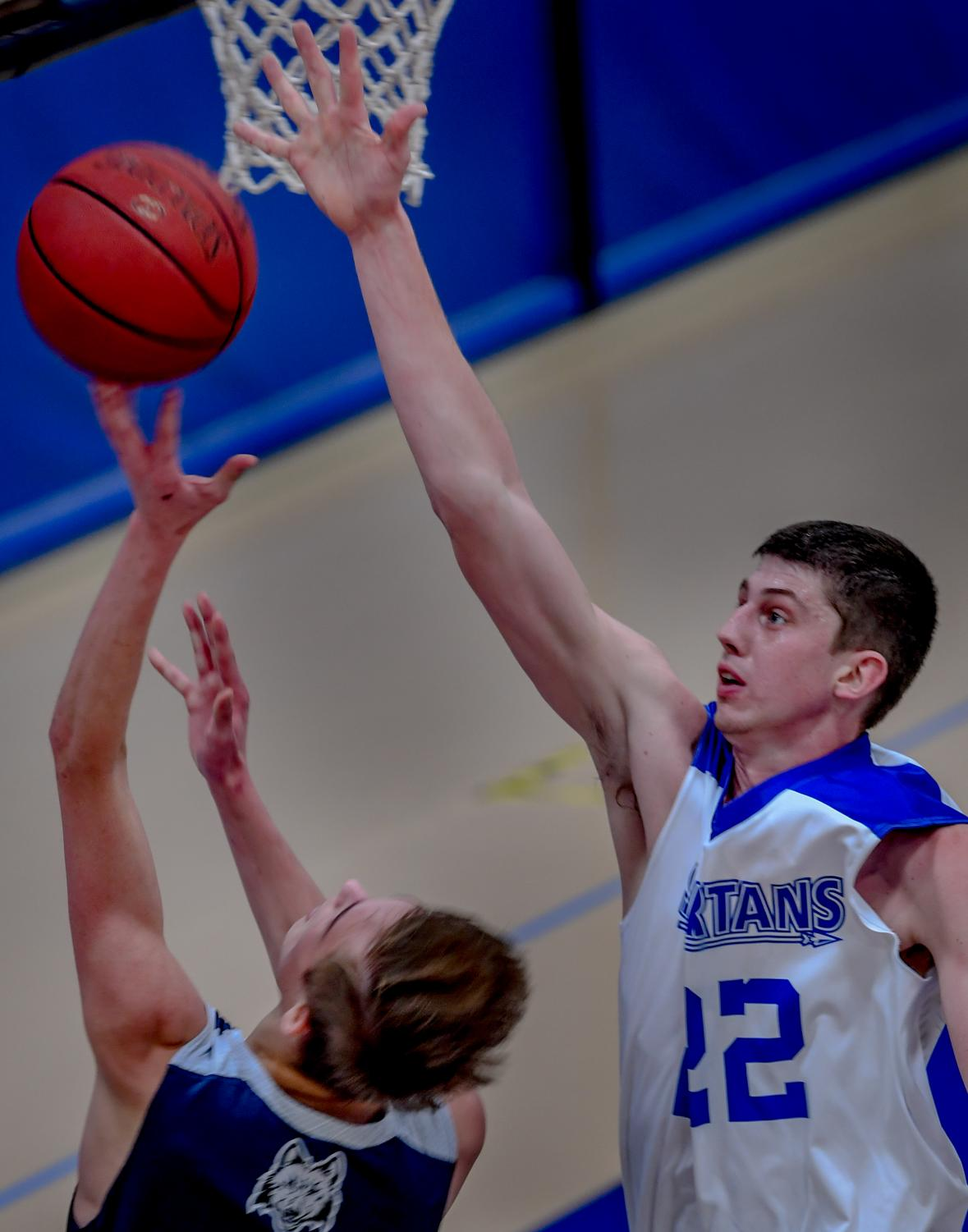 ECC second-year student, Jonathan Flynn goes for a block during Region IV Semifinal game on Feb. 23.