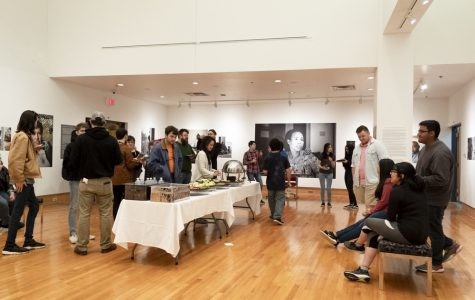 The Safety-Kleen Gallery gets a full house during a reception on its latest collection,