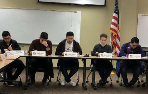 Student body president publicly resigns during student government meeting