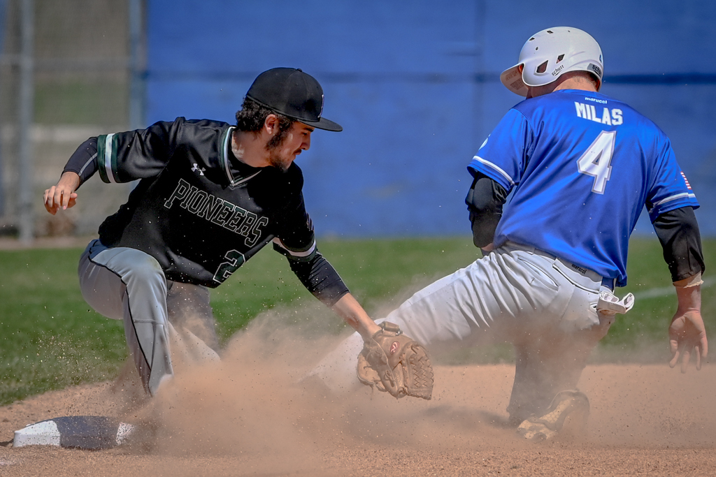 Clay Milas escapes the tag as he slides into second base. The Spartans outscored the Praire State Pioneers 54-9 during an April 19-20 two-game series.