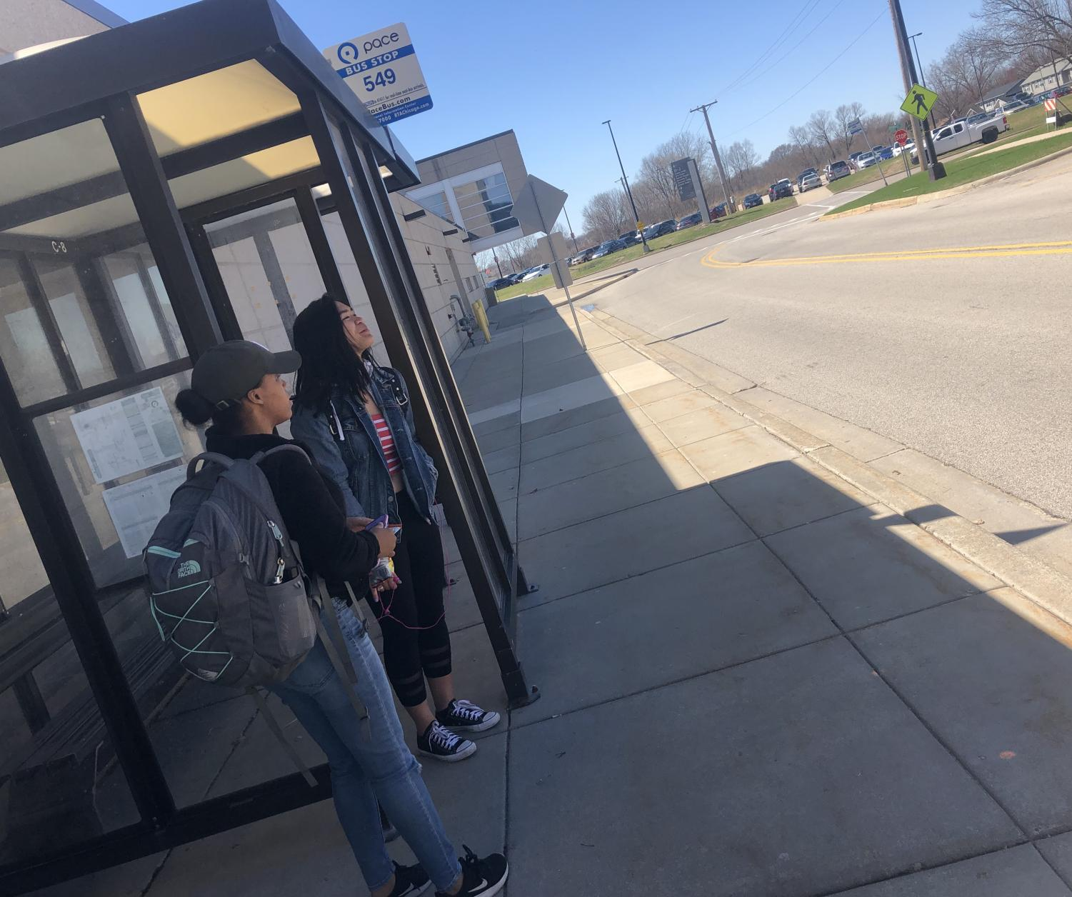 Naja May-Pearson waiting after school for the 2:23 p.m. Pace bus.