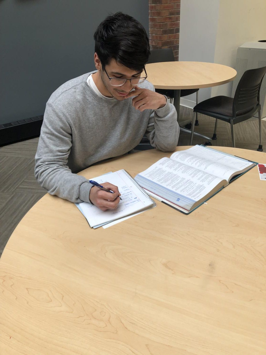 Third-year student Eduardo Luna tackles on a calculus problem.