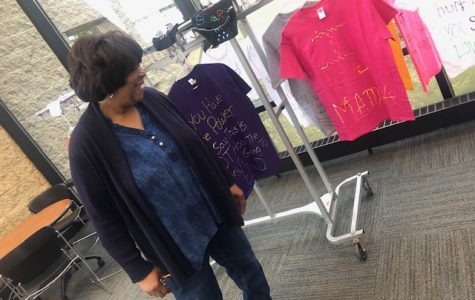 Volunteer Annie Yung showing herr shirt she made
