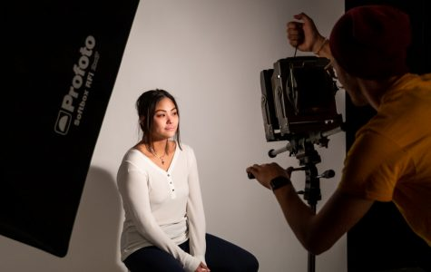 Bo Russell in the lighting studio using a 4x5 view camera to capture portraits of Cyra Oh.