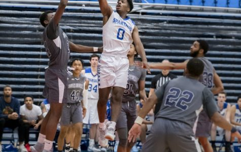 Elgin Community College men's basketball play a close, intense game against South Suburban College, winning 86-80 on Nov. 7. Julian Harvey leaps high with finger roll shot.