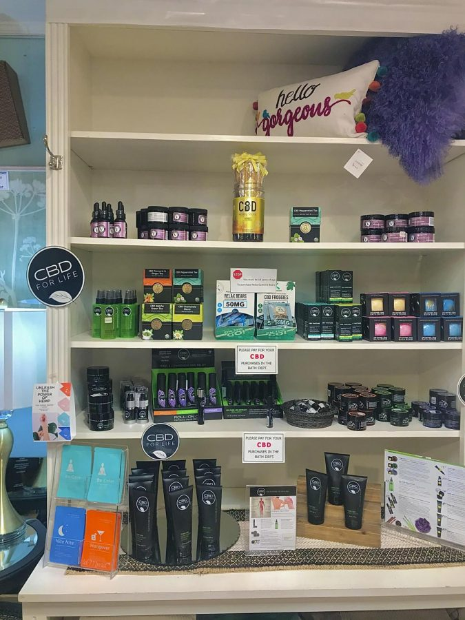 CBD products displayed at The Little Traveler in Geneva, Illinois.