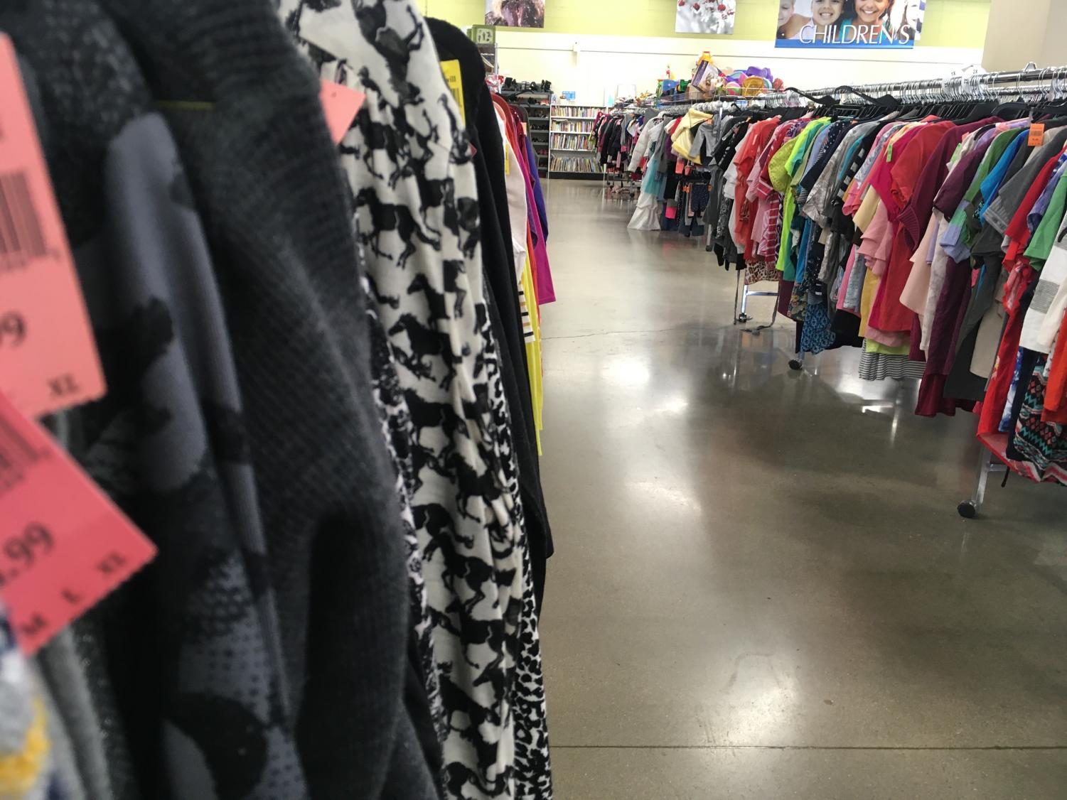 Goodwill, along with other thrift shops, have recently been raising prices. This aisle shows clothes with pink price tags.