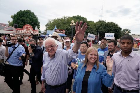 Senators Sanders and his wife wave to patrons during their 2019 visit to the Iowa State Fair
