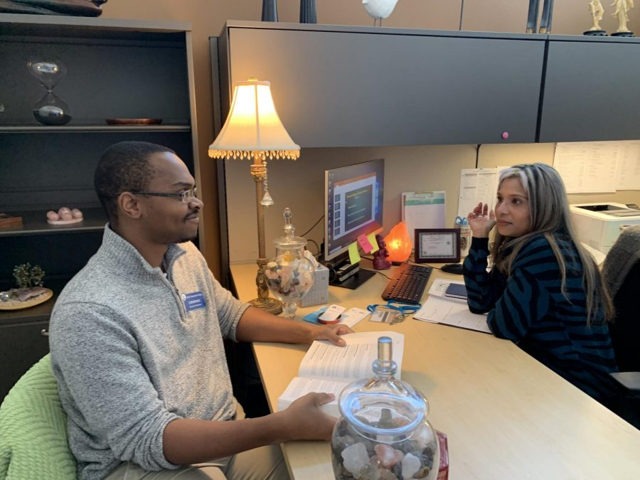 ECC's new wellness professionals Premlata Nikonikun and Coresair Mack in their office.