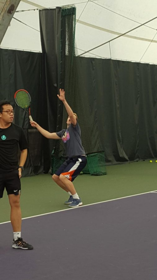 ECC Men's Tennis first-singles practicing serves during the last practice before first meet.