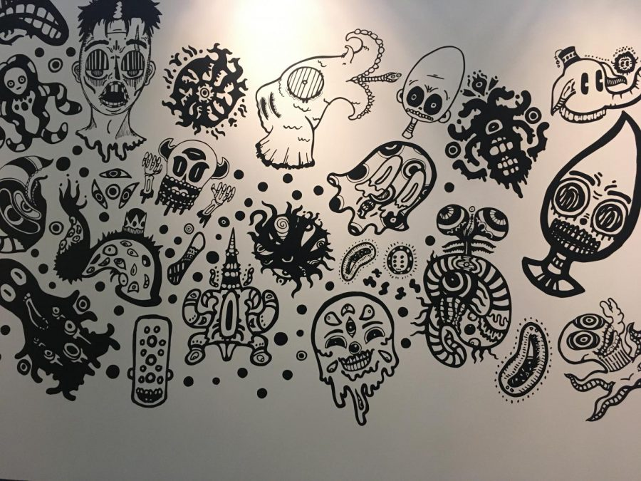 A portion of Josh Selvig's half of the mural being created in the Renner Library Hallway Gallery. Slevig used vinyl stickers to create this print.