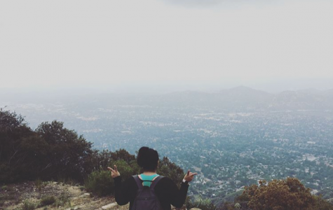 Melissa hiking at a mountain