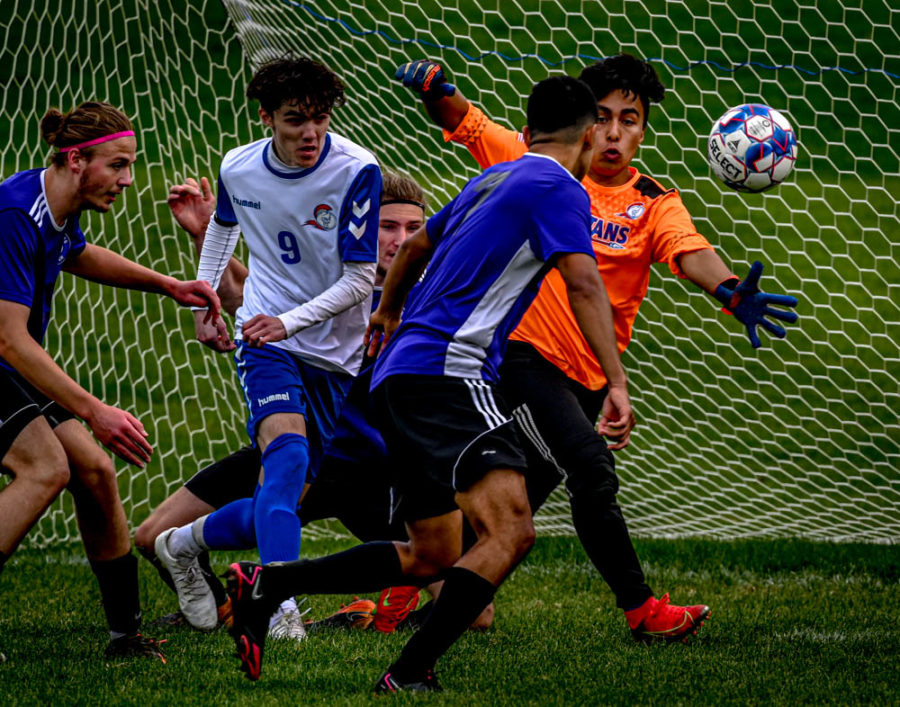 Action in the mens soccer match with Joliet.